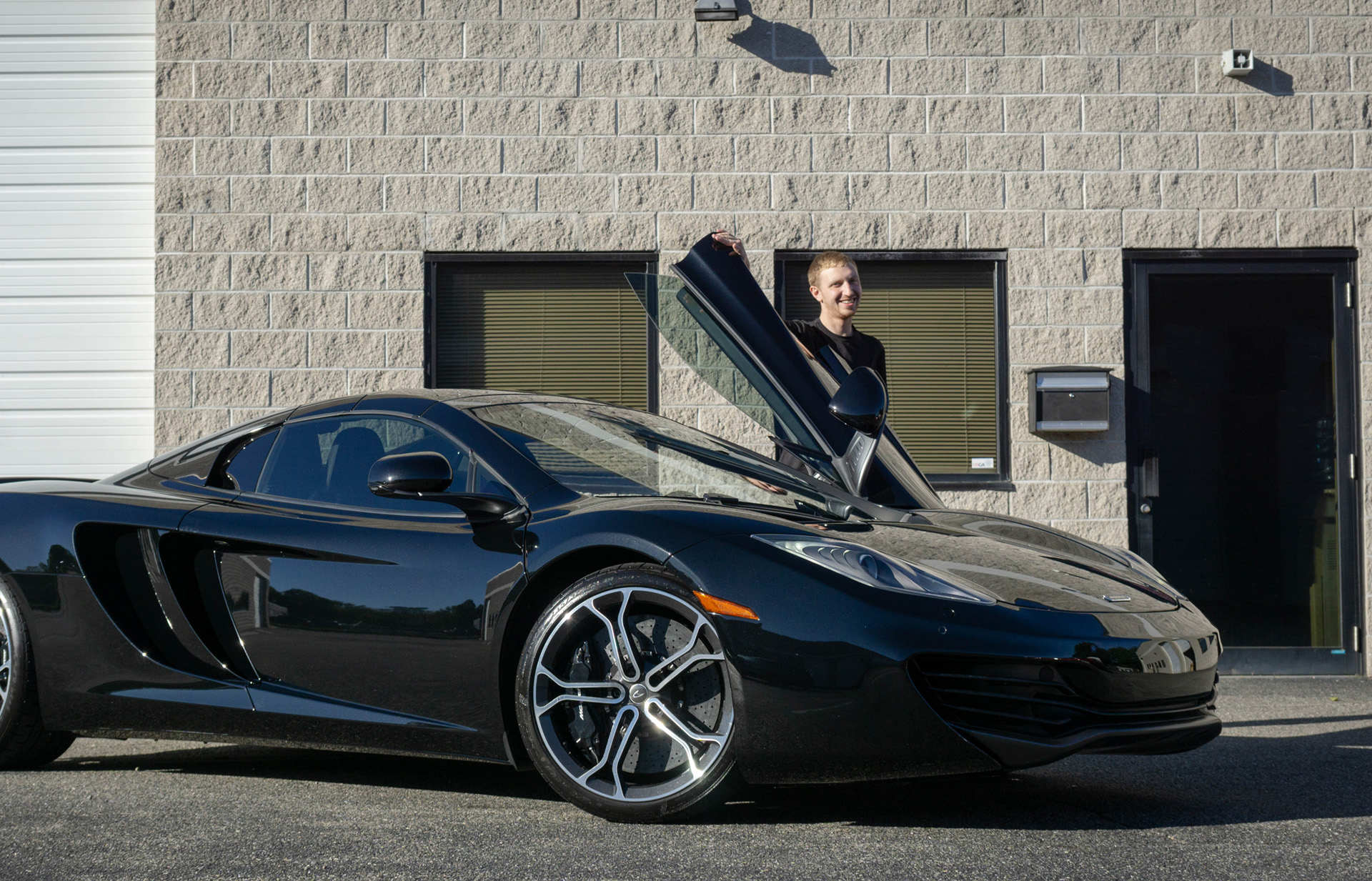 mclaren mp4-12c with person smiling
