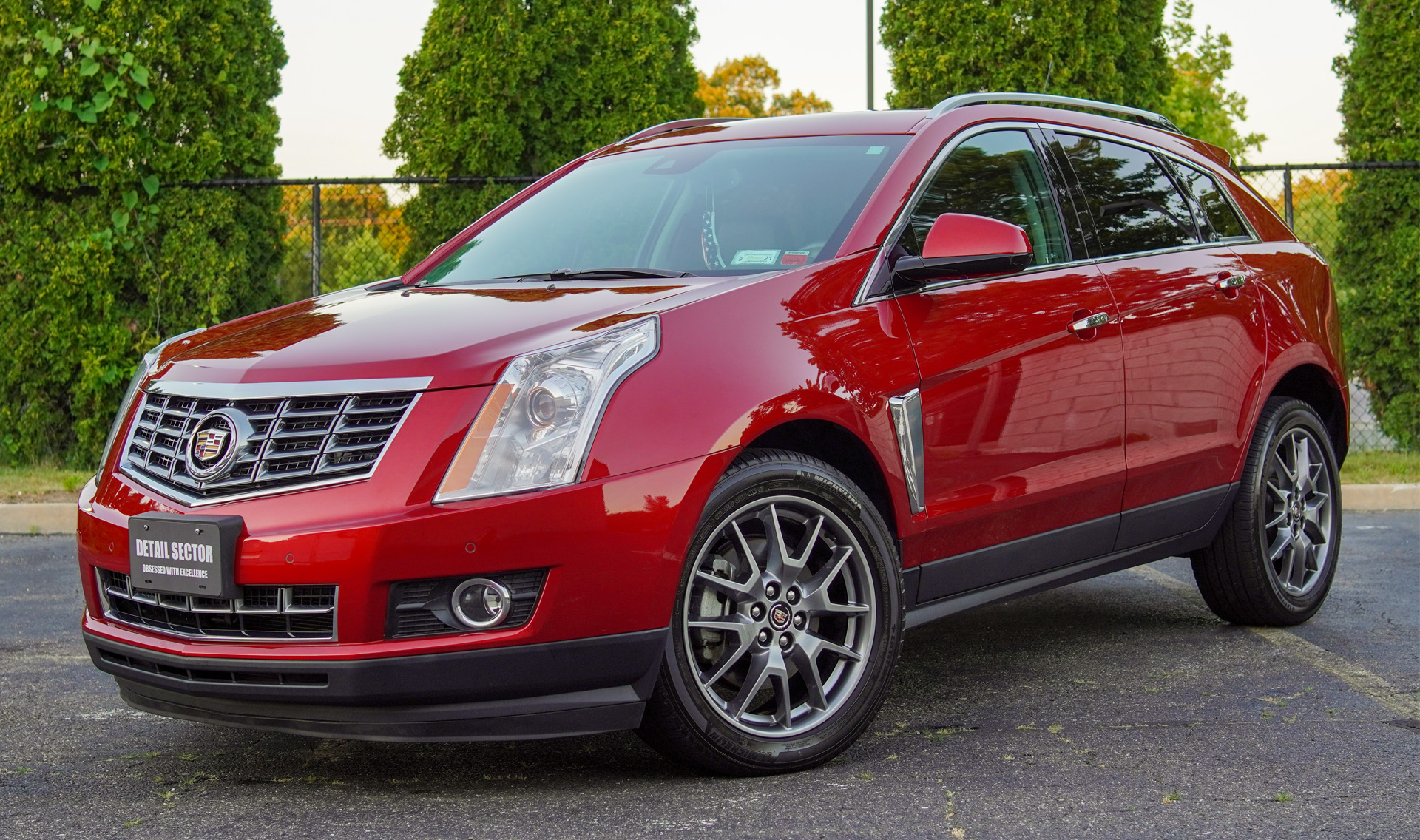 Red Cadillac SUV Outdoors